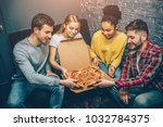 Small photo of Group picture of students where everybody is holding a peace of pizza. They are so hungry that they can't wait anymore and want to eat it right now. Party night