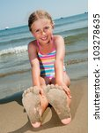 Summer fun - lovely girl playing on sandy beach - stock photo