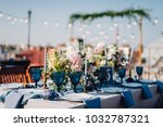 long dinner tables covered with ... | Shutterstock . vector #1032787321