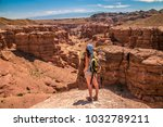women with backpack standing at ... | Shutterstock . vector #1032789211