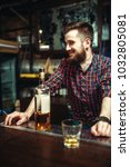 one man standing at the bar... | Shutterstock . vector #1032805081