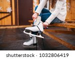 female person sitting on bench... | Shutterstock . vector #1032806419