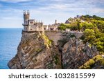 Small photo of Castle Swallow's Nest on the rock in Black Sea, Crimea, Russia. It is a symbol of Crimea. Scenic view of Crimea southern coast. Crimea landmark.