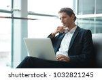 young handsome businessman... | Shutterstock . vector #1032821245