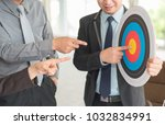 businessman pointing to company ... | Shutterstock . vector #1032834991