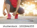 woman athlete tying running...   Shutterstock . vector #1032846355
