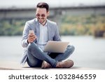 attractive man sitting outside  ... | Shutterstock . vector #1032846559