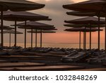silhuettes of beach loungers... | Shutterstock . vector #1032848269