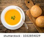 white bowl of pumpkin soup ... | Shutterstock . vector #1032854029