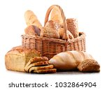 wicker basket with assorted... | Shutterstock . vector #1032864904