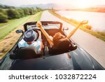 couple in love ride in... | Shutterstock . vector #1032872224