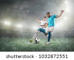 Small photo of Soccer players on a football field in dynamic action at summer day under sky with clouds. Sporty man is shooting the ball outdoor.