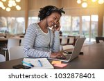 smiling young african college... | Shutterstock . vector #1032878401