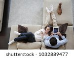 couple using digital tablet at... | Shutterstock . vector #1032889477