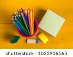 color pencils in metal grid... | Shutterstock . vector #1032916165