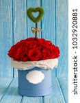 red roses flowers in a blue box ...   Shutterstock . vector #1032920881