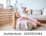 happy mother and daughter... | Shutterstock . vector #1032921481