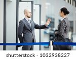 young airport security staff...   Shutterstock . vector #1032938227