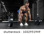 muscular man working out in gym ... | Shutterstock . vector #1032951949