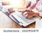 women hands typing on the... | Shutterstock . vector #1032953479