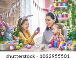 happy holiday  a mother and her ...   Shutterstock . vector #1032955501