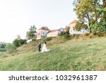 happy bride and groom on the... | Shutterstock . vector #1032961387