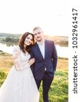 happy bride and groom on the... | Shutterstock . vector #1032961417