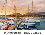 yachts parking in harbor at... | Shutterstock . vector #1032963691