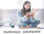 beautiful girl on a white sofa... | Shutterstock . vector #1032964495