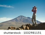 young female traveller is using ... | Shutterstock . vector #1032981151