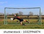 teenage boy goalkeeper saving... | Shutterstock . vector #1032996874