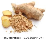 ginger with dried powder over... | Shutterstock . vector #1033004407