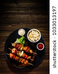 shish kebabs   grilled meat and ... | Shutterstock . vector #1033013197