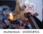 suckling pig roast at a... | Shutterstock . vector #1033018921