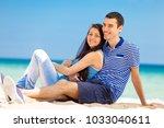in love couple on the sea beach ... | Shutterstock . vector #1033040611