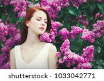 young redhead girl in white...   Shutterstock . vector #1033042771
