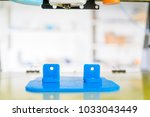 3d printer of the device during ... | Shutterstock . vector #1033043449