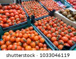 cherry tomatoes on the market ... | Shutterstock . vector #1033046119