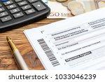 german tax form with pen money... | Shutterstock . vector #1033046239