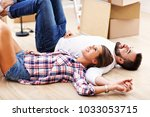 happy adult couple moving out... | Shutterstock . vector #1033053715