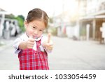 cute asian little girl in... | Shutterstock . vector #1033054459