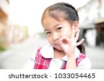 cute asian little girl in... | Shutterstock . vector #1033054465