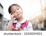 cute asian little girl in... | Shutterstock . vector #1033054501