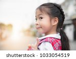 cute asian little girl in... | Shutterstock . vector #1033054519