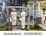 production of pralines in a... | Shutterstock . vector #1033058431