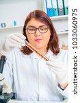 girl teen in the laboratory of... | Shutterstock . vector #1033060975