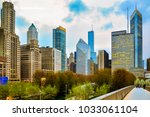 Stock photo chicago downtown skyline in the evening seen from pedestrian bridgeway 1033061104