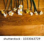 yellow flowers on wooden... | Shutterstock . vector #1033063729