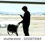 waiting at the airport | Shutterstock . vector #1033073365