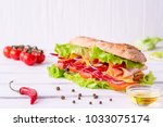 preparing a crusty fresh... | Shutterstock . vector #1033075174